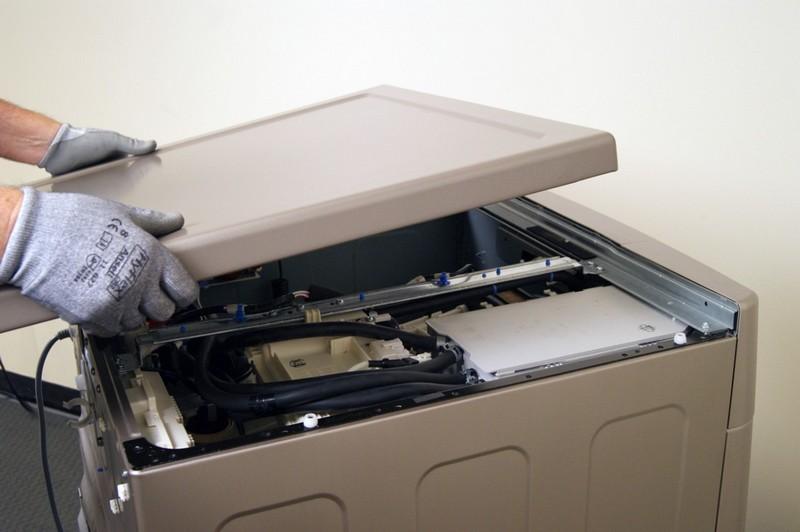 Сломалась крышка стиральной машины: что делать